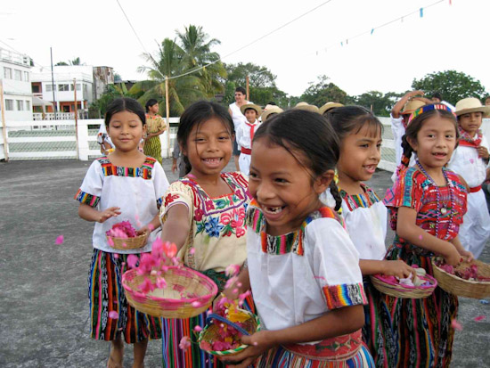 Guatemalan school children dance to celebrate the arrival of the surgical team.
