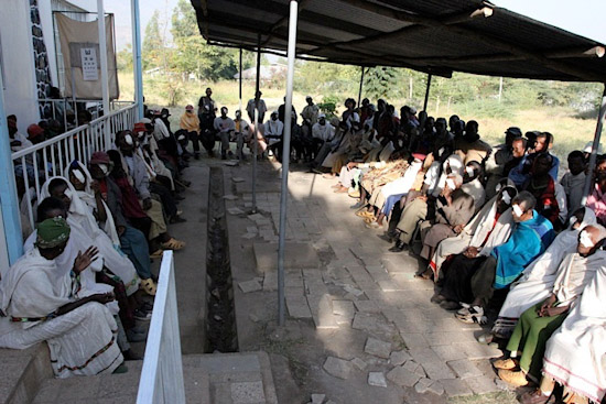 80 patients await the removal of their patches after having cataract surgery the day before.