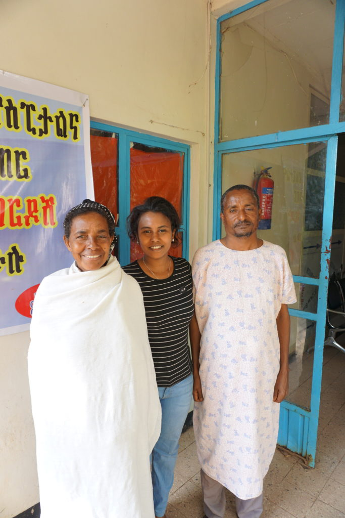 Dr. Hiwot with 2 patients post glaucoma surgery.